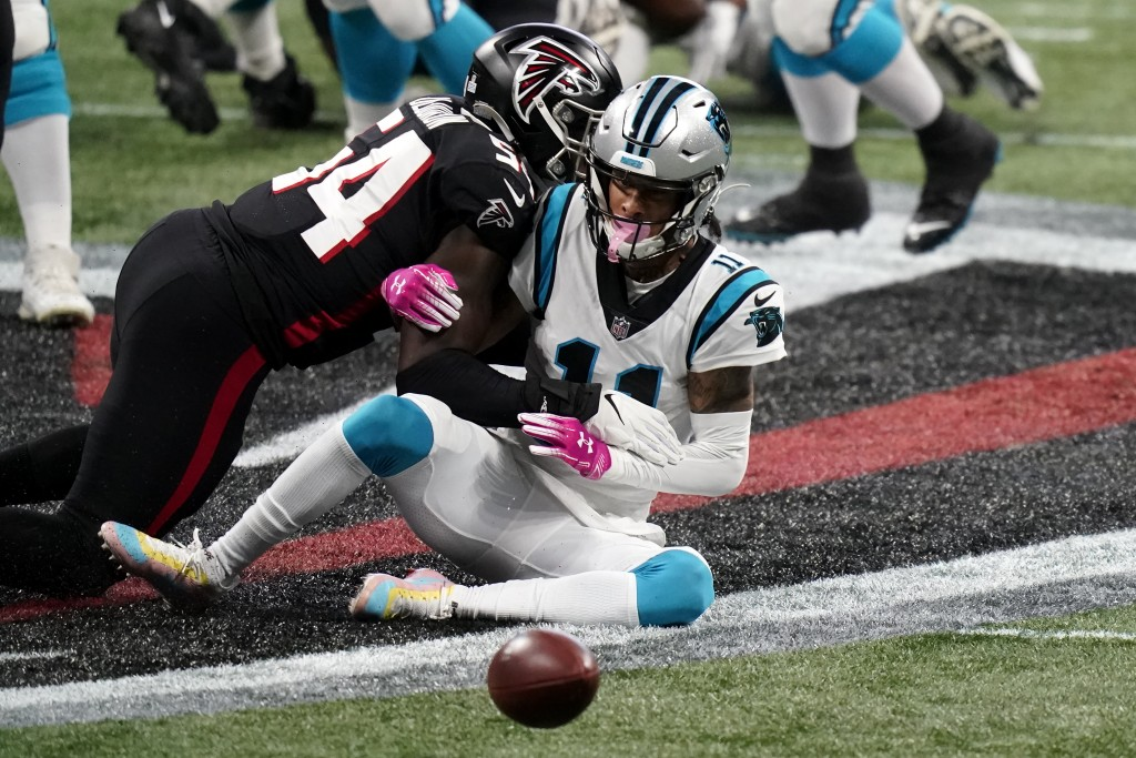 Carolina Panthers wide receiver Robby Anderson (11) misses the catch against Atlanta Falcons linebacker Foye Oluokun (54) during the first half of an ...