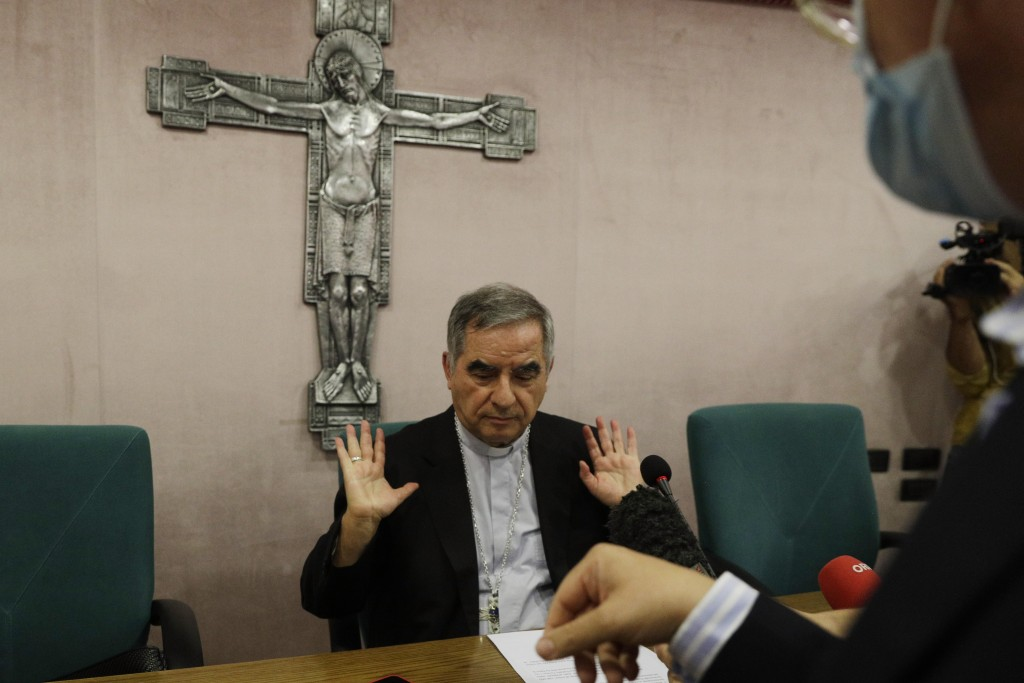 FILE - In this Sept. 25, 2020 Cardinal Angelo Becciu talks to journalists during a press conference in Rome. Italy's financial police said Wednesday, ...