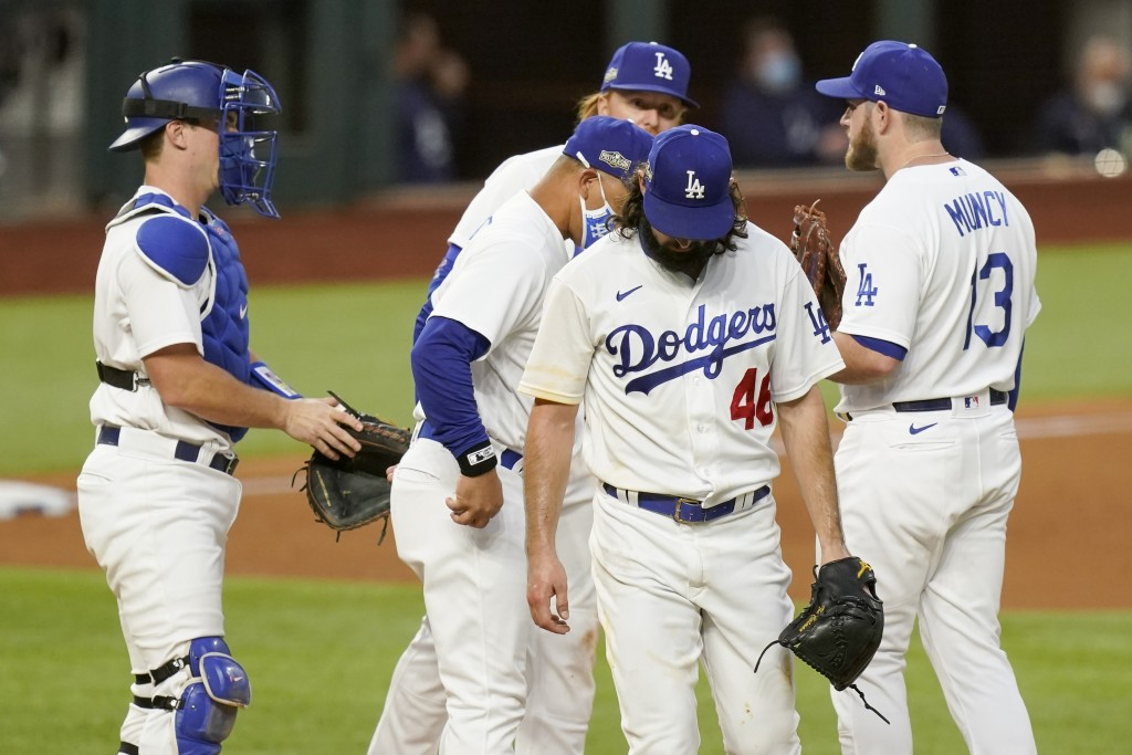 Los Angeles Dodgers starting pitcher Tony Gonsolin leaves the game during the fifth inning in Game 2 of a baseball National League Championship Series...