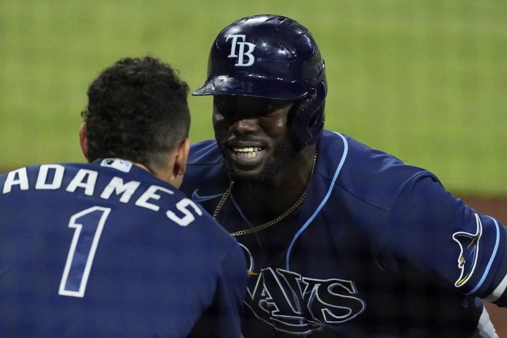 Tampa Bay Rays Randy Arozarena celebrates his two run home run with Rays' Willy Adames during the fourth inning against the Houston Astros in Game 4 o...