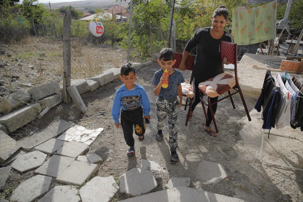 Bulgarian Roma children of the Topchu family walk in a village on the outskirts of Burgas, Bulgaria, Monday, Sept. 28, 2020. (AP Photo/Vadim Ghirda)