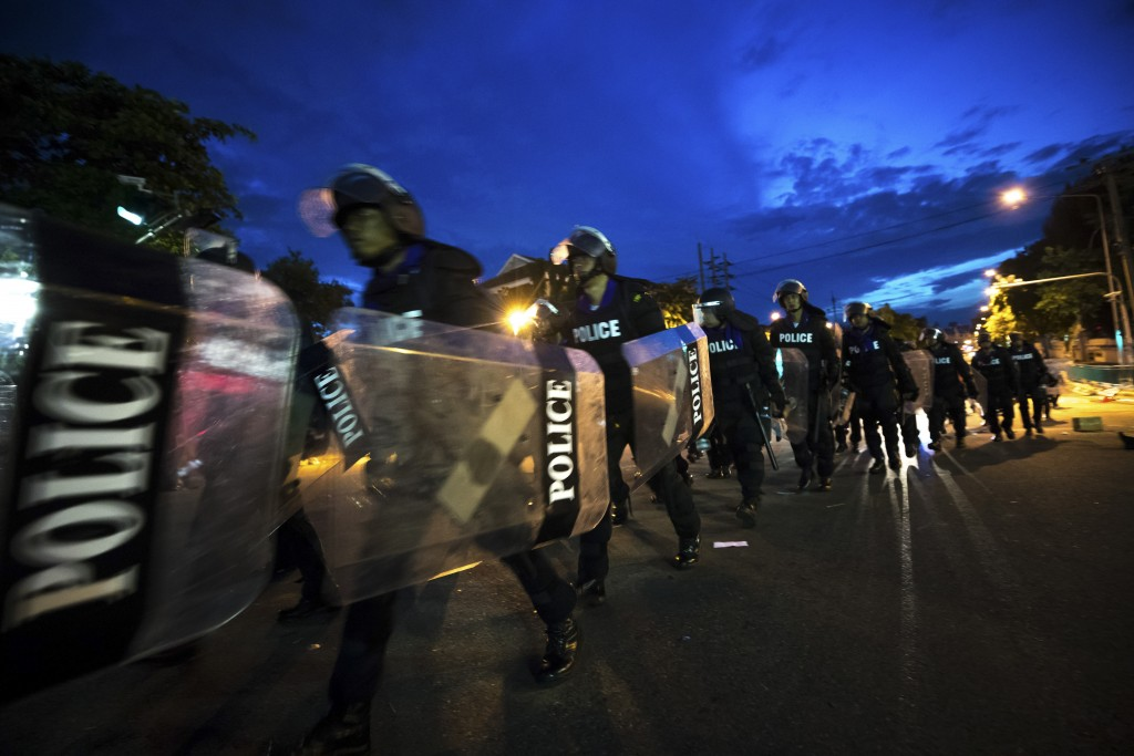 Riot Police move in with riot shields to disperse pro-democracy protesters from encroaching on the Government House in Bangkok, Thailand, Thursday, Oc...