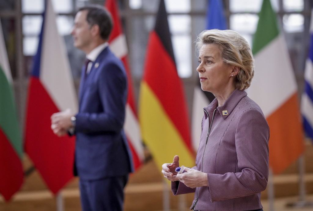 European Commission President Ursula von der Leyen, right, and Belgium's Prime Minister Alexander De Croo speaks with the media as they arrive for an ...