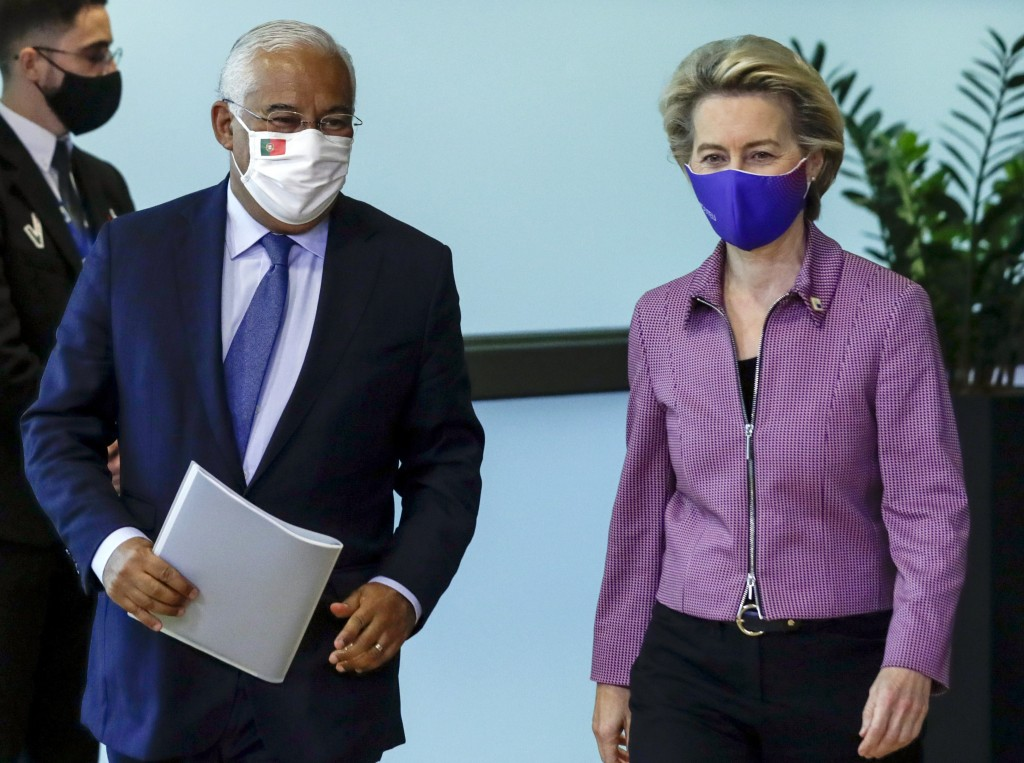 Portugal's Prime Minister Antonio Costa, left, is welcomed by European Commission President Ursula von der Leyen prior to a meeting at EU headquarters...