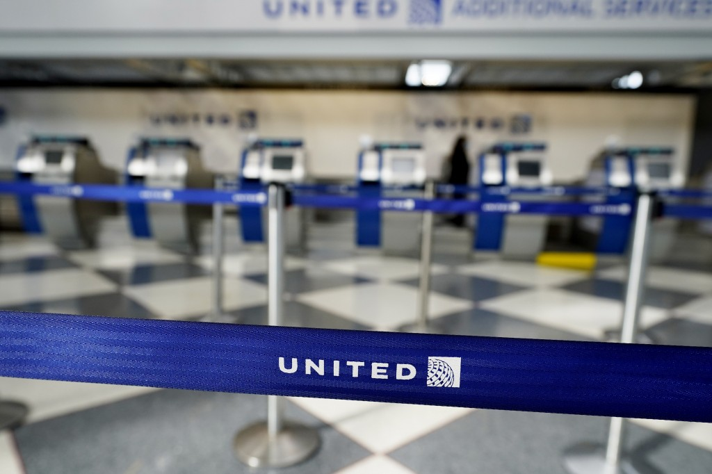 Empty ticketing counters are seen in Terminal 1 at O'Hare International Airport in Chicago, Wednesday, Oct. 14, 2020. United Airlines, which furloughe...