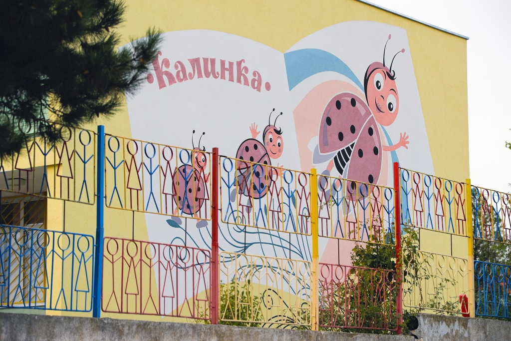 Ladybirds are painted on the wall of a kindergarten in a village on the outskirts of Burgas, Bulgaria, Monday, Sept. 28, 2020. Human rights activists ...