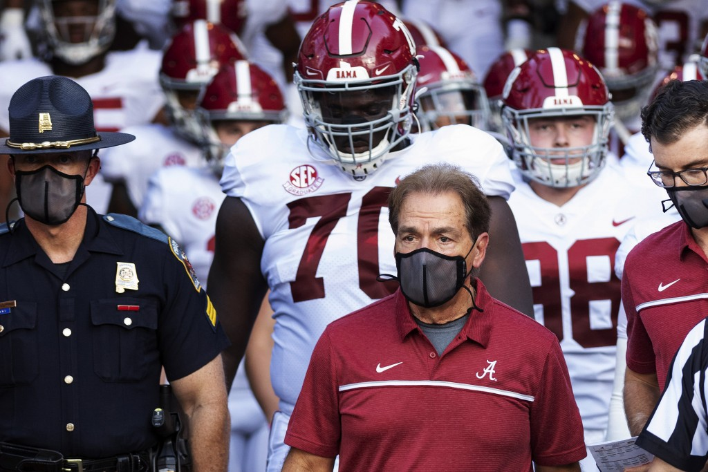 FILE - In this Sept. 26, 2020, file photo, Alabama coach Nick Saban leads his team to the field before an NCAA college football game against Missouri ...