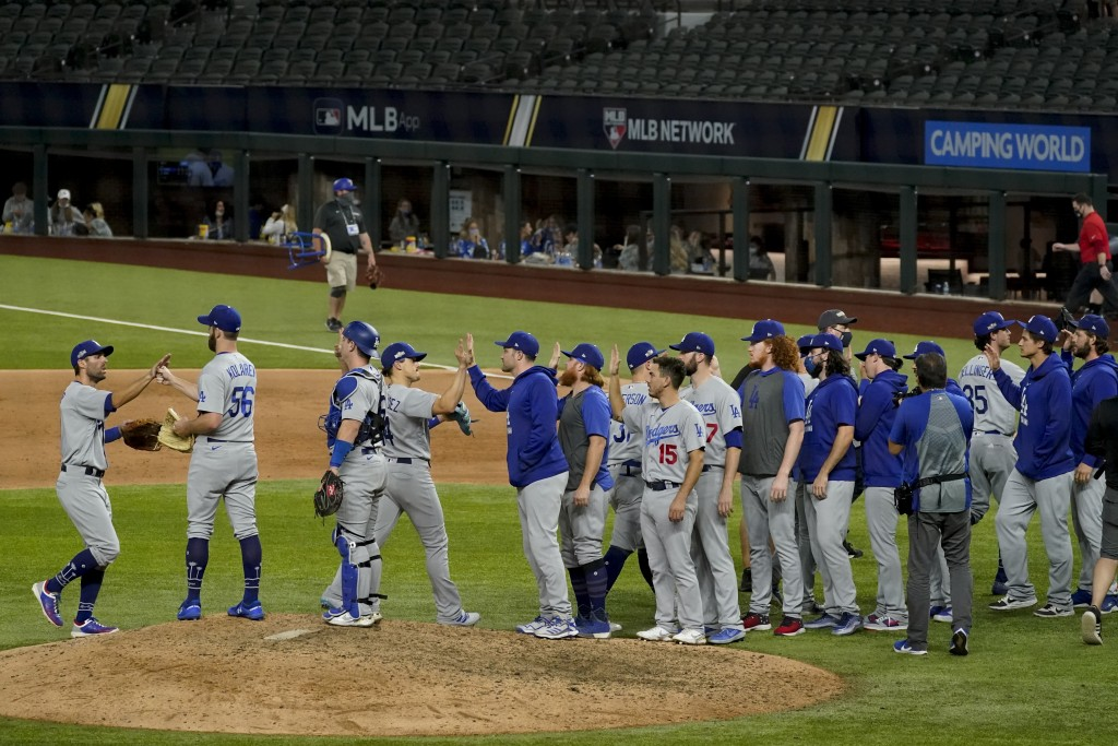 Los Angeles Dodgers celebrate their win against the Atlanta Braves in Game 3 of a baseball National League Championship Series against the Atlanta Bra...