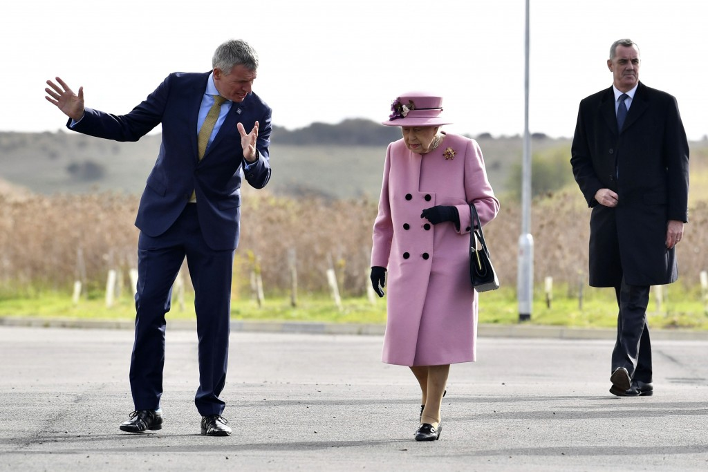Britain's Queen Elizabeth II is greeted by Chief Executive Gary Aitkenhead prior to a visit to the Defence Science and Technology Laboratory (DSTL) at...
