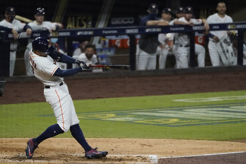 Houston Astros George Springer hits a two run home run against the Tampa Bay Rays during the fifth inning in Game 4 of a baseball American League Cham...