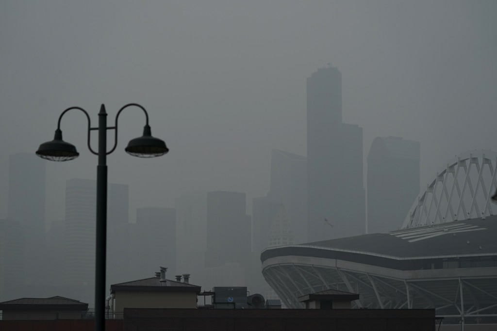 FILE - In this Sept. 14, 2020, file photo, downtown Seattle is barely visible through wildfire smoke, Wednesday, Oct. 14, 2020, near CenturyLink Field...