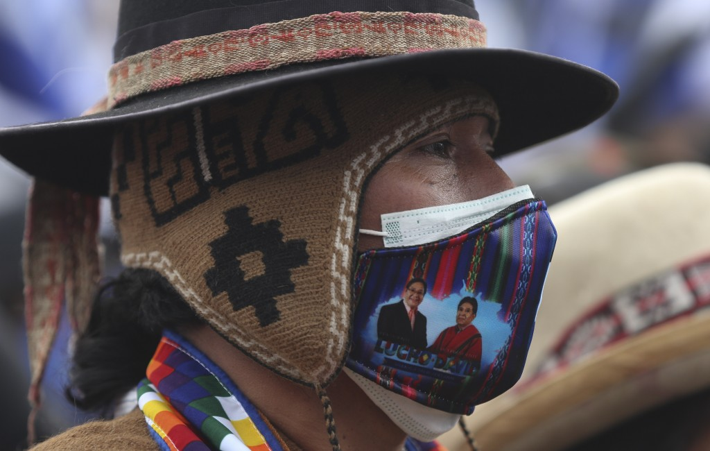 A supporter of Luis Arce, who is running for president for the Movement Towards Socialism Party, MAS, attends Arce's closing campaign rally in El Alto...