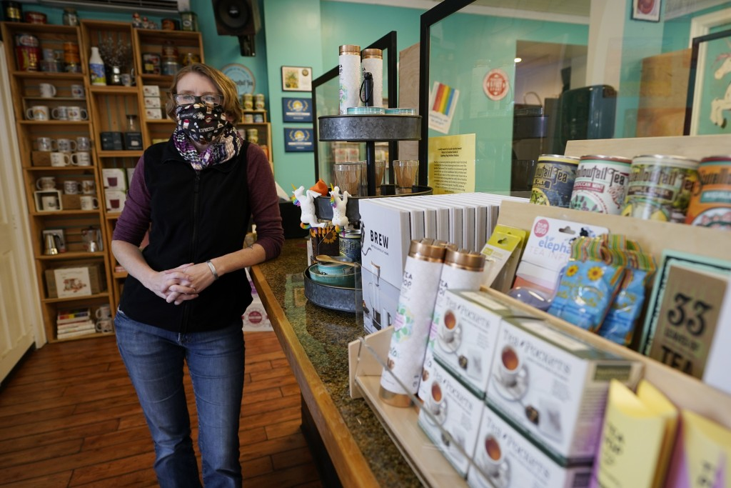 Victoria Leigh Kidd, owner of Hideaway Café, poses in her shop in the Old Town area Wednesday Oct. 7, 2020, in Winchester, Va. The viral pandemic has ...