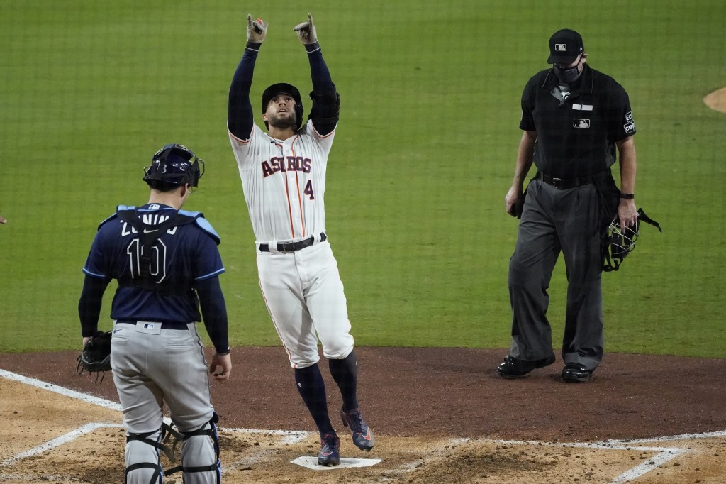 Tampa Bay Rays catcher Mike Zunino watches as Houston Astros George Springer celebrates his two run home run against the Tampa Bay Rays during the fif...