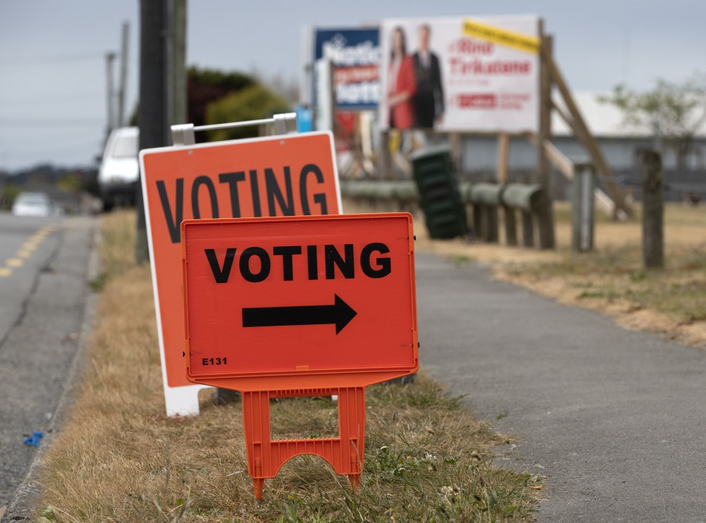 Signs direct voters to an early voting booth in Christchurch, New Zealand, Wednesday, Oct. 14, 2020. Opinion polls indicate New Zealand Prime Minister...