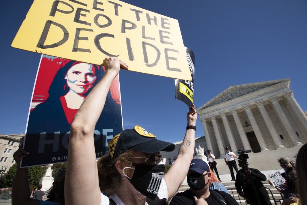 People protest for and against the confirmation of President Donald Trump's Supreme Court nominee Amy Coney Barrett, rally at the Supreme Court on Cap...