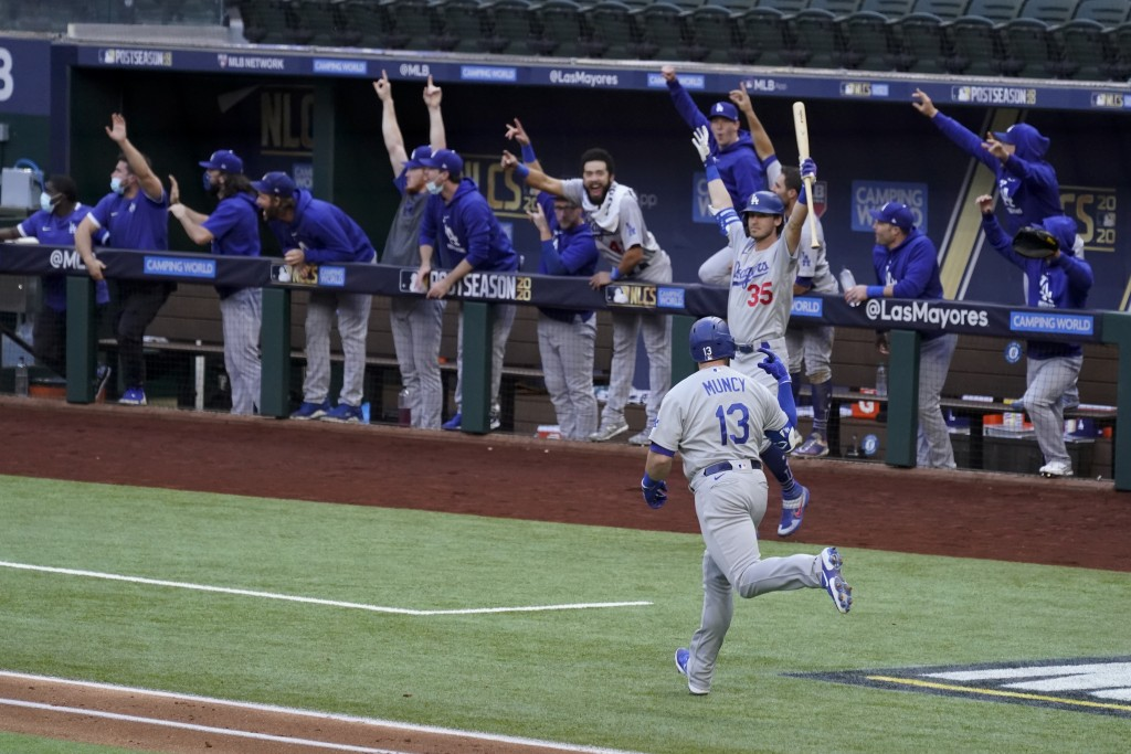 Los Angeles Dodgers' Max Muncy (13) celebrates his grand slam home run during the first inning in Game 3 of a baseball National League Championship Se...