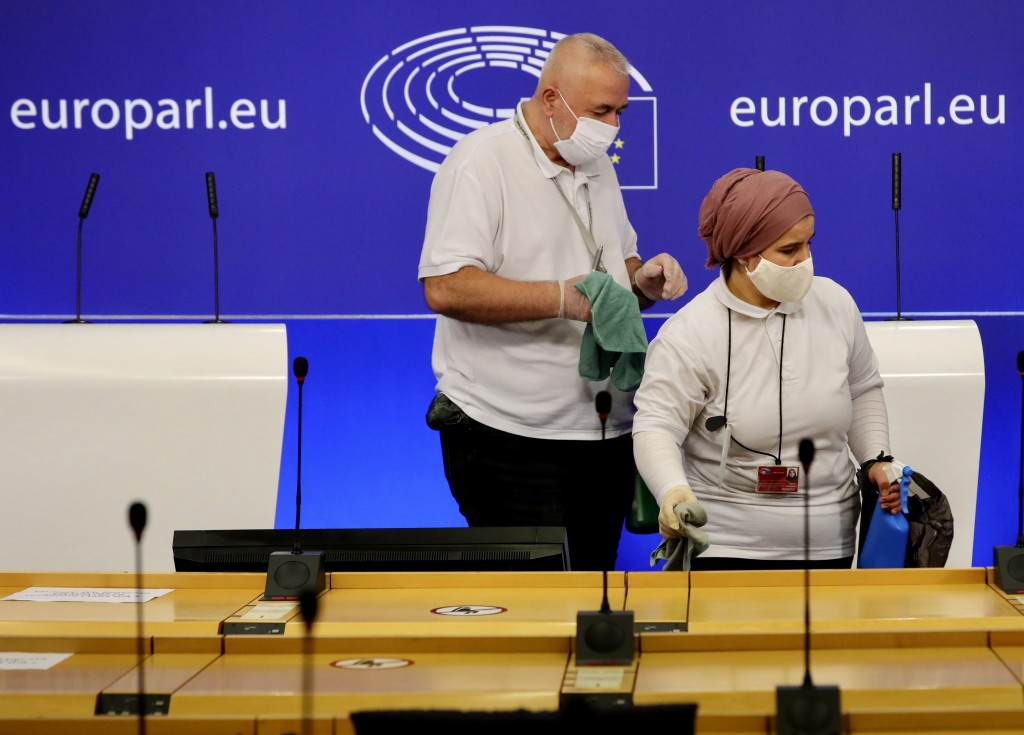 Members of the cleaning crew sanitize a room prior to a media conference of Sinn Fein's President Mary Lou McDonald at the European Parliament in Brus...