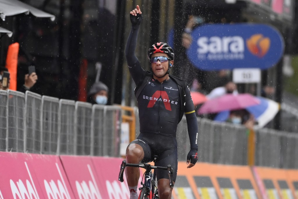 Ecuador's Jhonatan Narváez celebrates as he crosses the finish line to win the 12th stage of the Giro d'Italia cycling race, from Cesenatico to Cesena...