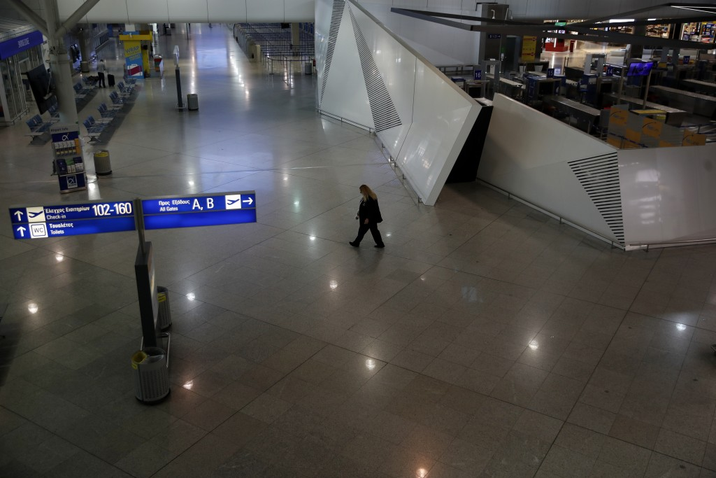 A security walks at the empty Eleftherios Venizelos International Airport during a 24-hour strike in public sector in Athens, Thursday, Oct. 15. 2020....