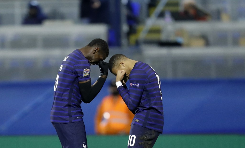 France's Kylian Mbappe, right, celebrates with France's Paul Pogba after scoring his side's second goal during the UEFA Nations League soccer match be...