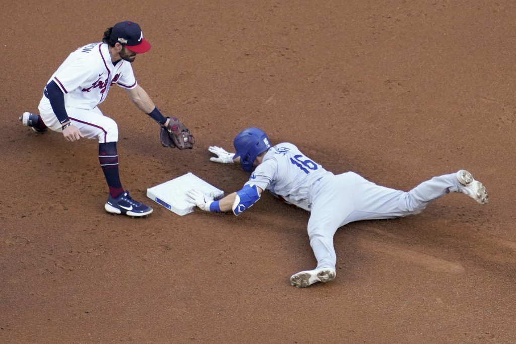 Los Angeles Dodgers' Will Smith is safe at second past Atlanta Braves shortstop Dansby Swanson after a double during the first inning in Game 3 of a b...