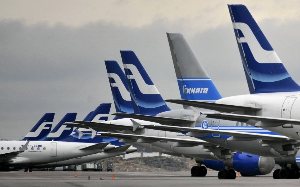 FILE - In this Monday, Nov. 16, 2009 file photo, passenger planes of the Finnish national airline company Finnair stand on the tarmac at Helsinki inte...