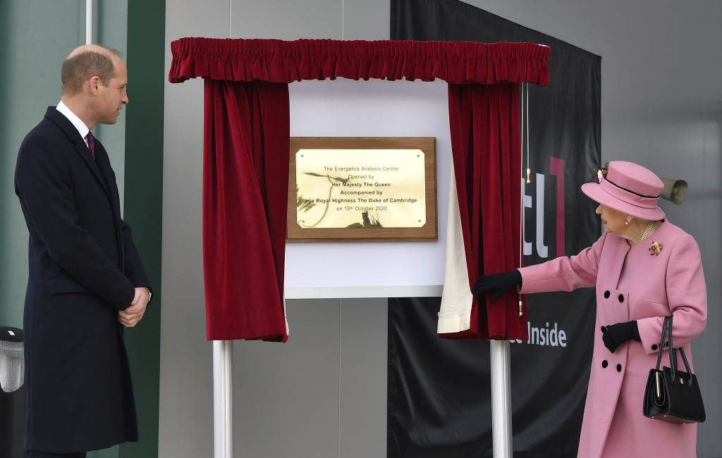 Britain's Prince William looks on as Queen Elizabeth II unveils a plaque to officially open the new Energetics Analysis Centre at the Defence Science ...