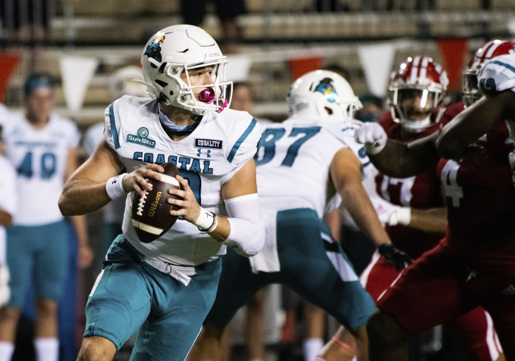 Coastal Carolina quarterback Grayson McCall (10) rolls out to attempt a pass during the first half of an NCAA football game against Louisiana-Lafayett...