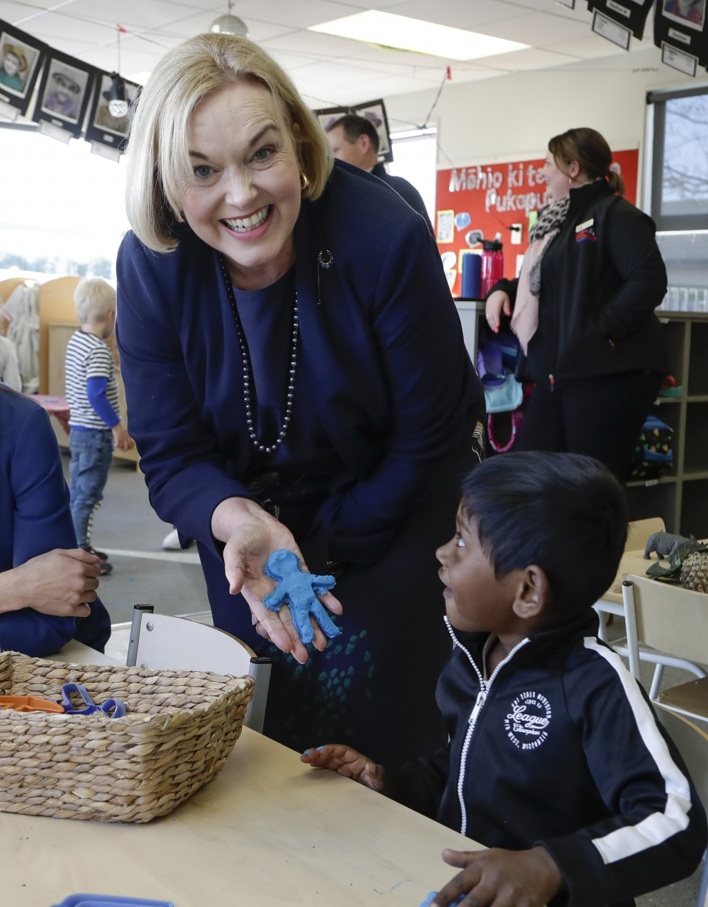 FILE - In this July 30, 2020, file photo, leader of New Zealand opposition National Party Judith Collins reacts with a young child while campaigning a...