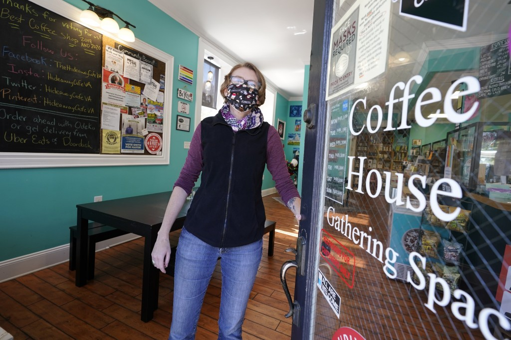 Victoria Leigh Kidd,  owner of Hideaway Café, opens the front door of her shop in the Old Town area Wednesday Oct. 7, 2020, in Winchester, Va.  The vi...