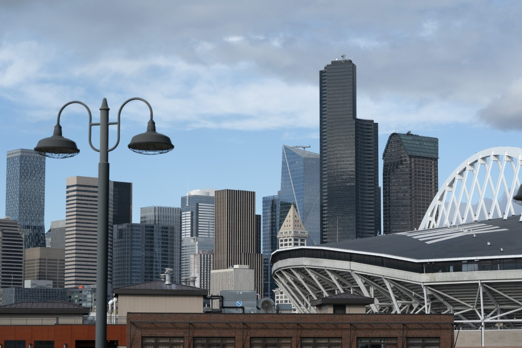 Downtown Seattle is seen under clear skies Wednesday, Oct. 14, 2020, near CenturyLink Field, right, as viewed from an upper deck of T-Mobile Park, the...