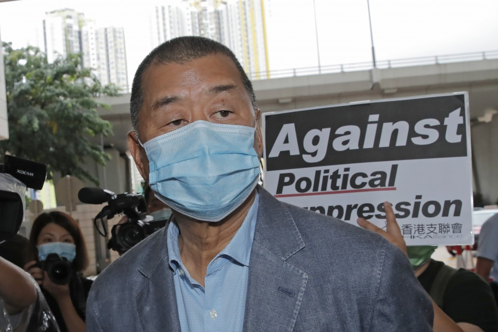 FILE - In this Sept. 15, 2020, file photo, Jimmy Lai, among various of groups of pro-democracy activists, arrives at a court in Hong Kong. Hong Kong p...