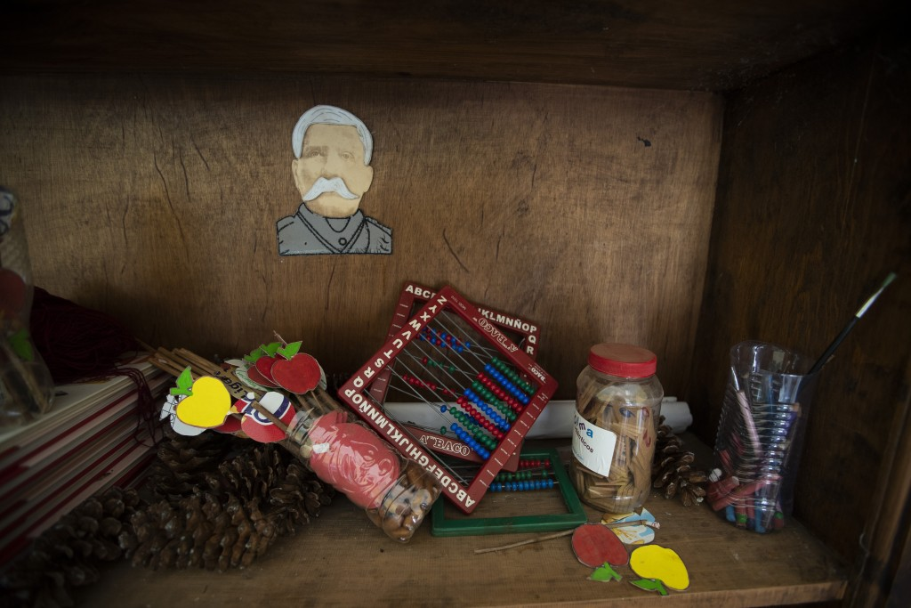 Unused school materials lay on a shelf at a school in the community of Nuevo Yibeljoj, Chiapas state, Mexico, Friday, Sept. 11, 2020. Amid the new cor...