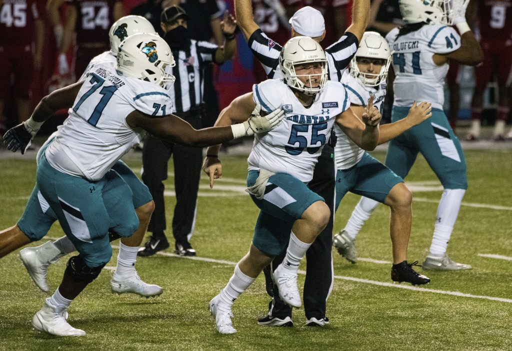 Coastal Carolina players celebrate after place kicker Massimo Biscardi (29) kicked the go-ahead and eventual game-winning field goal during the second...