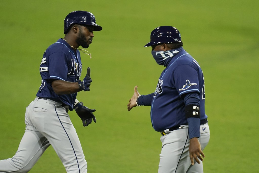 Tampa Bay Rays Randy Arozarena celebrates his two run home run with third base coach Rodney Linares during the fourth inning against the Houston Astro...