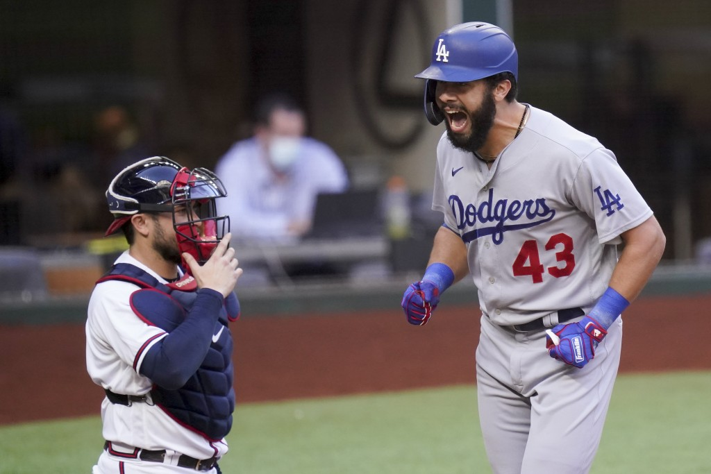 Los Angeles Dodgers Edwin Rios celebrates his home run against the Atlanta Braves during the first inning in Game 3 of a baseball National League Cham...