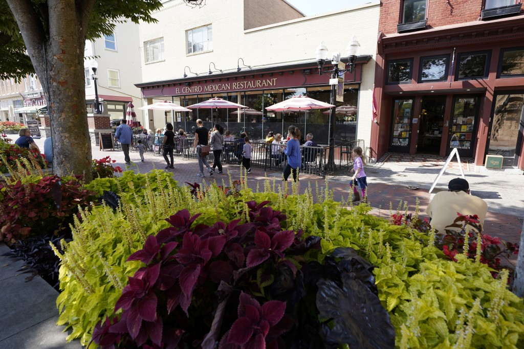 Pedestrians make their way along the downtown mall area of the Old Town Wednesday Oct. 7, 2020, in Winchester, Va.  The viral pandemic has hammered sm...