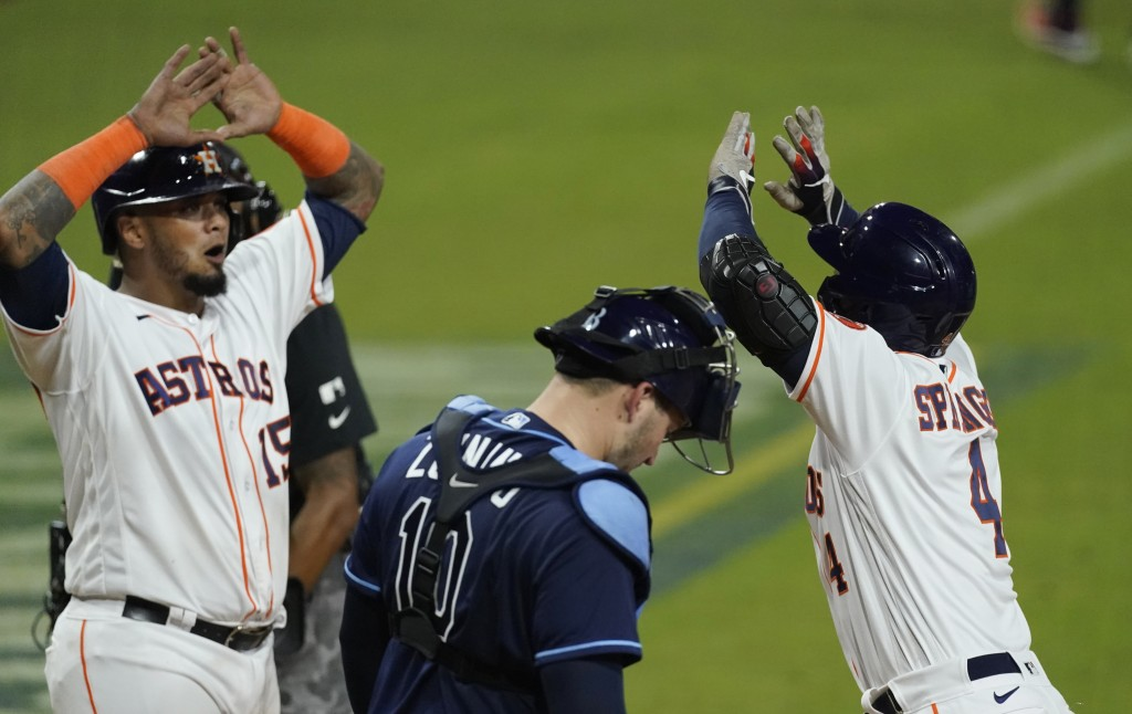 Houston Astros George Springer celebrates with teammate Martin Maldonado after hitting a two run home run against the Tampa Bay Rays during the fifth ...
