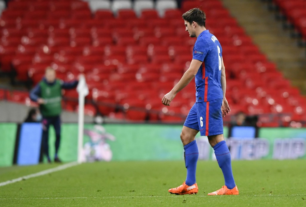 England's Harry Maguire walks from the field after he was shown a red card during the UEFA Nations League soccer match between England and Denmark at ...