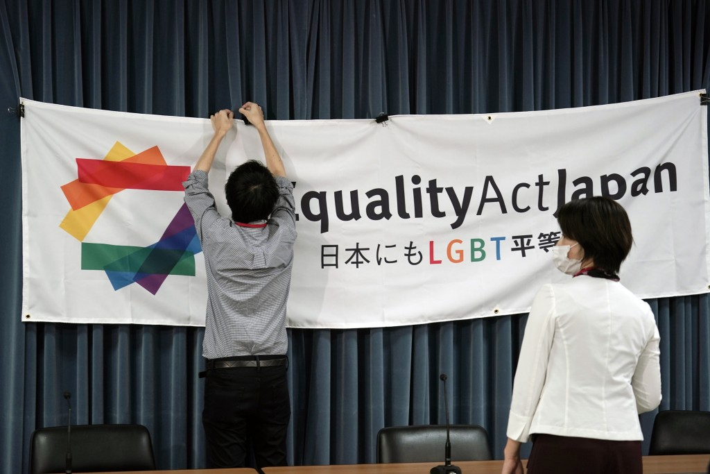 """A staff member adjusts a banner for a press conference to launch international signature campaign for the enactment of the """"LGBT Equality Law"""" as a le..."""