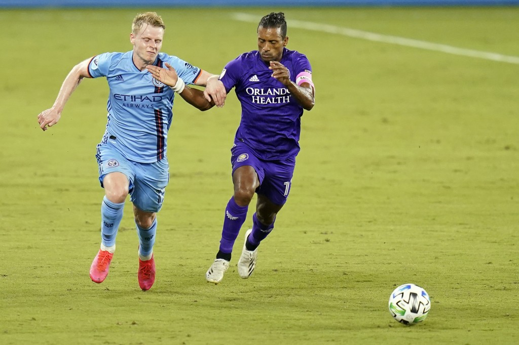 New York City FC midfielder Gary Mackay-Steven, left, fights for position on the ball against Orlando City forward Nani during the second half of an M...