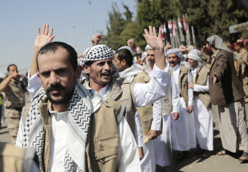 Yemeni prisoners chant slogans during their arrival after being released by the Saudi-led coalition at the airport in Sanaa, Yemen, Thursday, Oct. 15,...