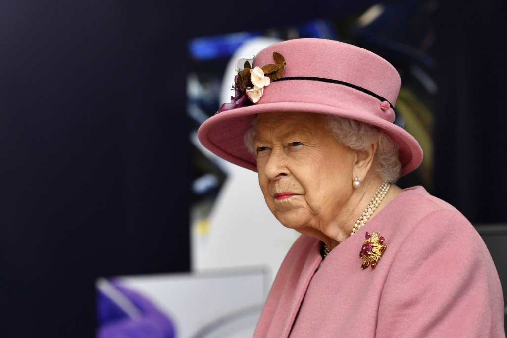 Britain's Queen Elizabeth II visits the Defence Science and Technology Laboratory (DSTL) at Porton Down, England, Thursday Oct. 15, 2020, to view the ...