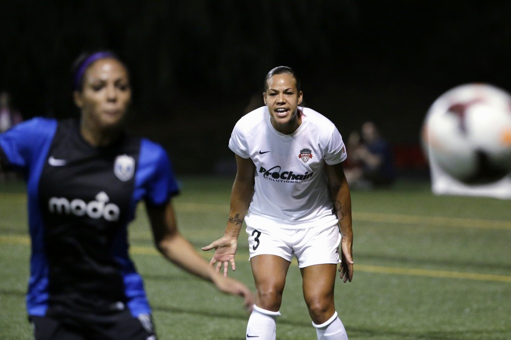 FILE - In this Aug. 24, 2014, file photo, Washington Spirit's Toni Pressley (3) yells as Seattle Reign FC's Sydney Leroux follows the ball during the ...
