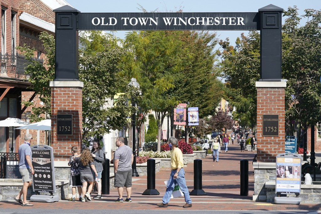 Pedestrians walk along the downtown mall area in the Old Town Wednesday Oct. 7, 2020, in Winchester, Va.  The viral pandemic has hammered small busine...