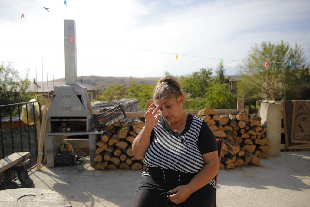 Azime Ali Topchu, 48, a Bulgarian Roma woman, gestures during an interview with the Associated Press in a village on the outskirts of Burgas, Bulgaria...