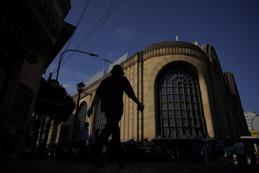 A man walks outside the Abasto Shopping Mall amid the new coronavirus pandemic in Buenos Aires Argentina, Wednesday, Oct. 14, 2020. After seven months...