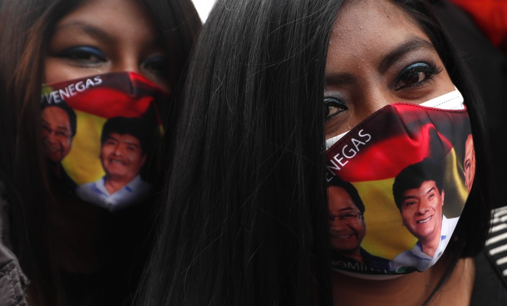 Supporters of Bolivian presidential candidate for the Movement Towards Socialism Party, MAS, Luis Arce, participate in hiw closing campaign rally for ...