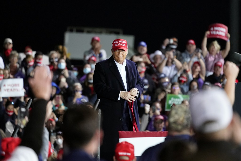 President Donald Trump listens to supporters during a campaign rally at Des Moines International Airport, Wednesday, Oct. 14, 2020, in Des Moines, Iow...